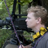 Filming Red Ruffed Lemurs from a tree platform, Masoala, Madagascar 2010
